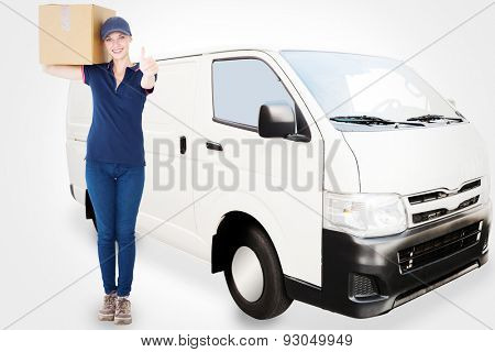 Happy delivery woman holding cardboard box against white delivery van