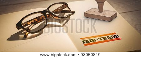Fair Trade graphic against glasses on notepad