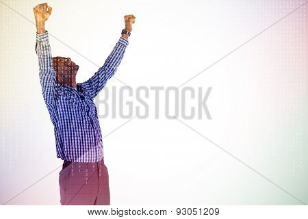 Excited businessman cheering against server room with towers