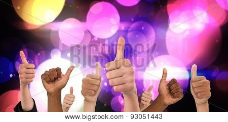 Hands showing thumbs up against digitally generated cool nightlife design