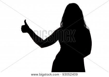 Silhouette of woman showing thumb