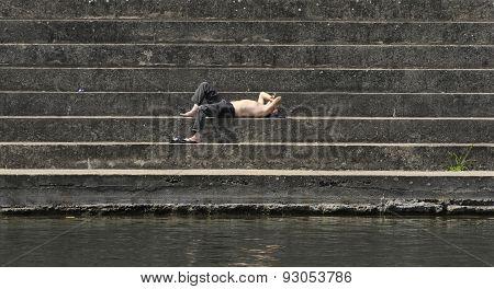 Single man sunbathing