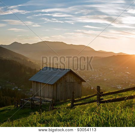 Wooden Hut At The Mountains