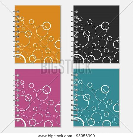 Set of four colorful notebook covers with white circles