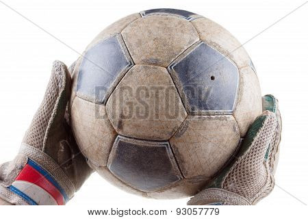 Soccer goalkeeper's gloves and the ball