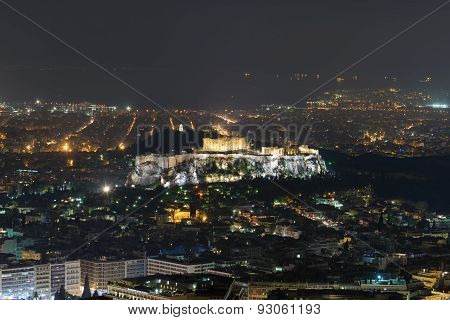 Acropolis in Athens with the city lights as background. Night view.