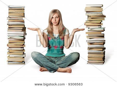 Woman In Lotus Pose With Many Books Near