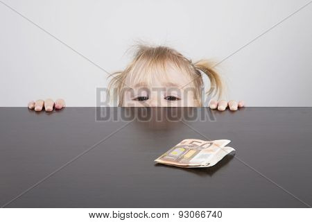 Baby Looking At Euro Banknote