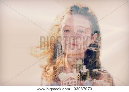 double exposure of teenage girl and city
