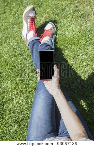 Phone In Hand Legged On Grass