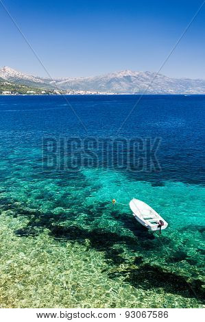 Clear Blue Beach At Korcula Croatia With Boat