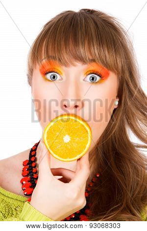Cute Young Woman With An Orange Fruit In A Mouth