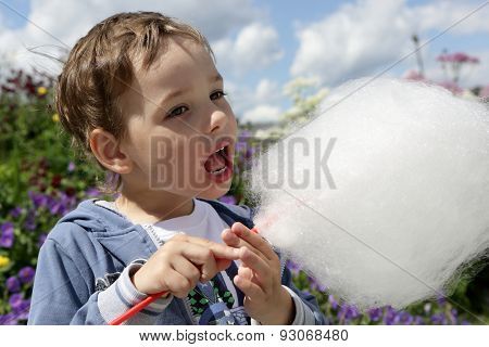 Boy Licks Cotton Candy