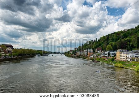 Neckar River at Heidelberg, Germany with historic buildings lining the river banks in a tourism and travel concept