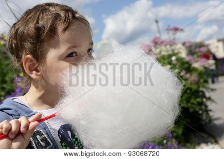 Kid Licks Cotton Candy