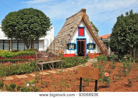 MADEIRA  ISLAND, PORTUGAL - OCTOBER 4, 2011: Charming white house with a gable roof. Old house-museum of the first settlers on the island of Madeira