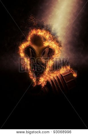 Old Fashioned Gas Mask, Used to Protect Against Inhalation of Dangerous Chemical Fumes and in War, on Fire and Dramatically Lit on Dark Background, Concept Image