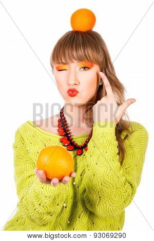 Cute Young Woman With An Orange Fruits
