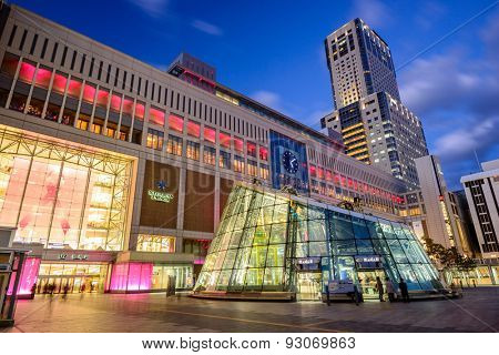SAPPORO, JAPAN - OCTOBER 19, 2012: Sapporo Station exterior at twilight. The adjacent Japan Railway building is the tallest in the city.