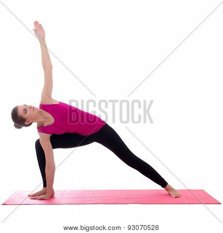 Beautiful Slim Sporty Woman Standing On Pink Mat In Yoga Pose Isolated On White