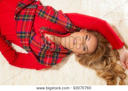 Pretty Blonde Girl In Christmas Red Robe & Laying Down.