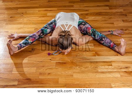 Female Yoga Model Kurmasana Tortoise Pose Overhead