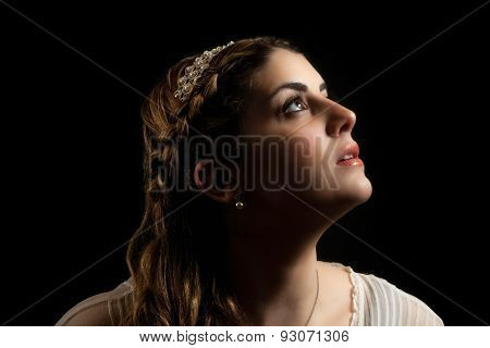 Girl In Headband Looking Up Into Air