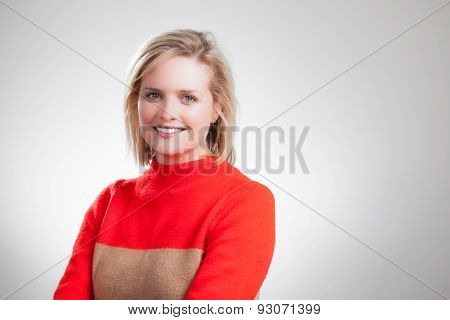 Young Pretty Blonde Orange Sweater Corporate Headshot