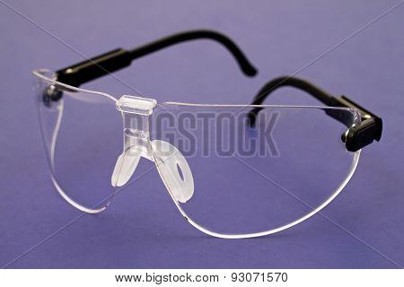 Safety Glasses On Blue