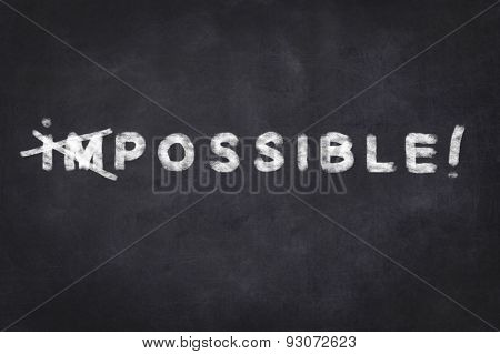 everything is possible - motivation text on chalkboard