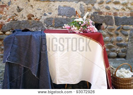 Table decorated with flowers. Color image