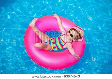 Cute Little Girl Playing In Swimming Pool