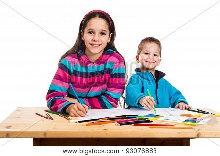 two happy kids learn to draw together