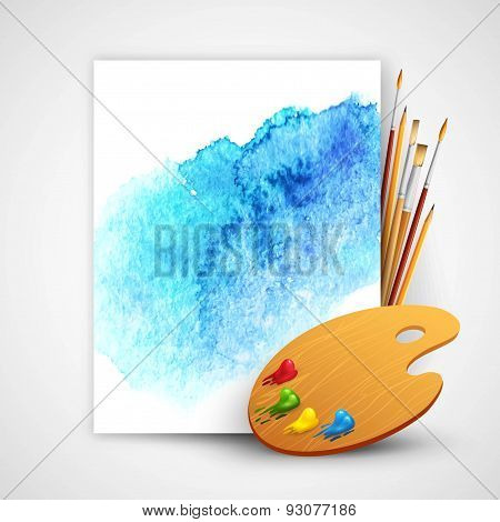 Realistic brush and palette on blue watercolor background