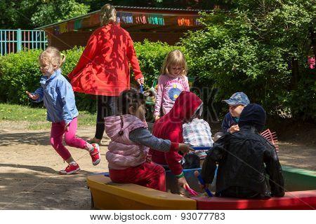 Children On The Playground In Nursery School