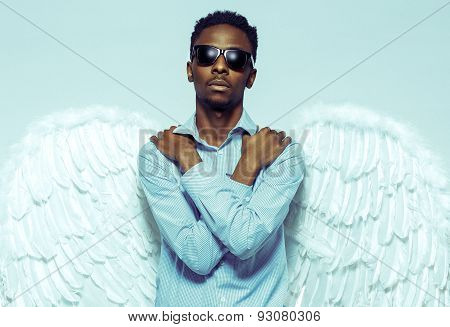 African American Man With Angel Wings In Sunglasses