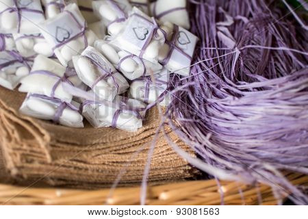 Basket With Purple Raffia And Confetti