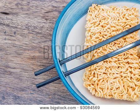 Instant Noodles In Bowl With Chopsticks