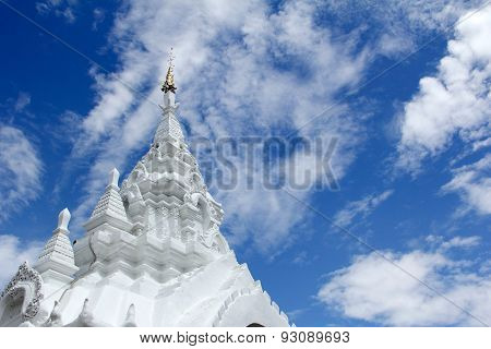 White Stucco Thai Buddhist Temple With Cloud