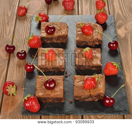 Chocolate Brownies With Strawberries And Cherries