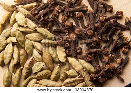 Oriental spice: cardamom seeds and cloves