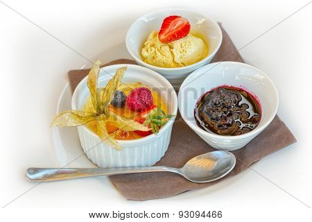 Creme brulee. French vanilla cream dessert with caramelised sugar on top with ice cream and fruit