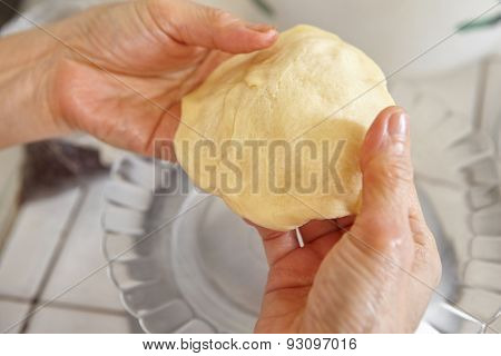 Shaping bread dough before filling with chocolate or cheese