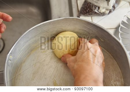 Arranging bread dough on the baking tray
