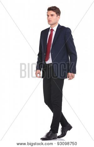 Full body of a young business man walking on isolated background.