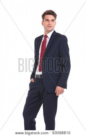Side view of a young business man holding his hand in pocket while looking away from the camera.