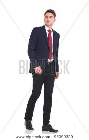 Side view of a business man looking away while walking on isolated background.