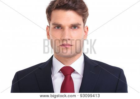 Close up picture of a handsome young business man looking at the camera.
