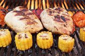 stock photo of roast chicken  - Barbecue Roast Chicken Breast With Vegetables On The Hot Flaming Charcoal Grill - JPG