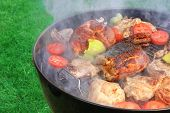 picture of baby back ribs  - Meat And Vegetables Mix On The Hot BBQ Charcoal Grill - JPG